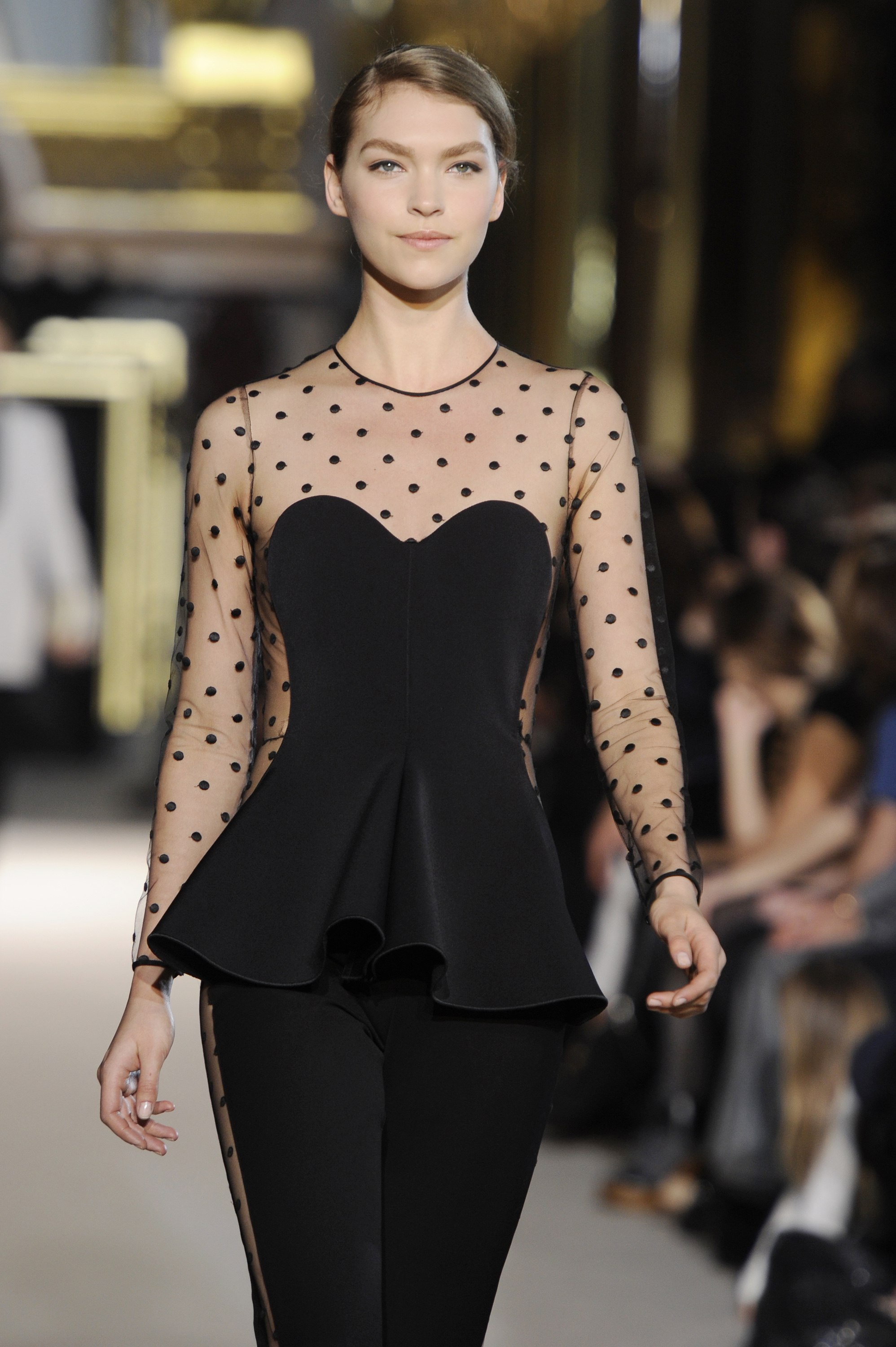 A model presents a creation by British designer Stella McCartney as part of her Fall-Winter 2011/2012 women's collection during Paris Fashion Week