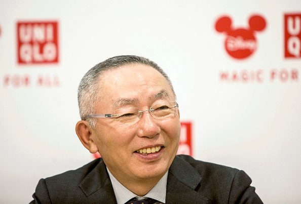 Tadashi Yanai, chairman, president and chief executive officer of Fast Retailing Co., smiles during an interview in Shanghai, China, on Saturday, Sept. 26, 2015. Yanai said Walt Disney Co.s new park in Shanghai will help his Uniqlo casual wear brand expand in China, shrugging off concerns over an economic slowdown in the Japanese retailers largest overseas market. Photographer: Qilai Shen/Bloomberg via Getty Images