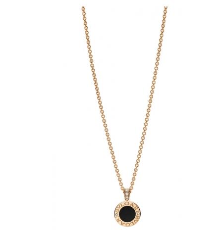 b851886a0584 La cadena y el círculo en donde se aprecia la marca estám hecho de oro rosa  con madre perla y el centro es de ónix.